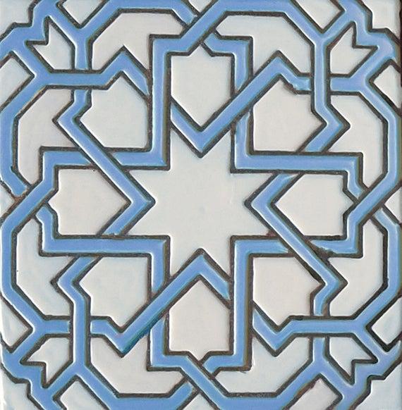 blue and white geometric Moorish tile
